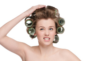 Woman-in-Rollers-hand-on-head